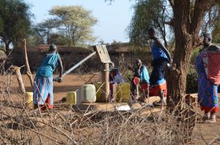 Maasai women pumping the water