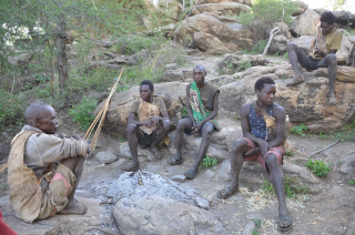 Hadzabe men at their fire